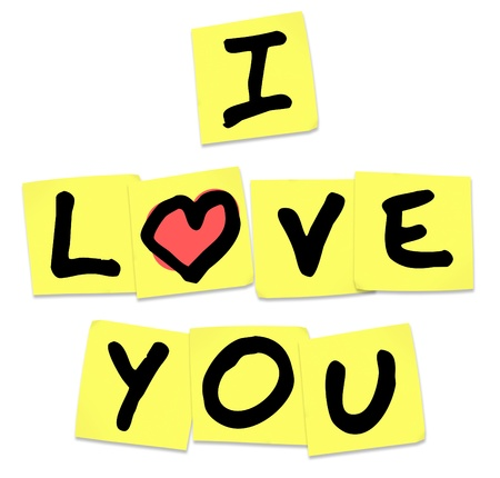 The words I Love You written on yellow sticky notes to share emotions, with an affectionate message of passion  Stock Photo