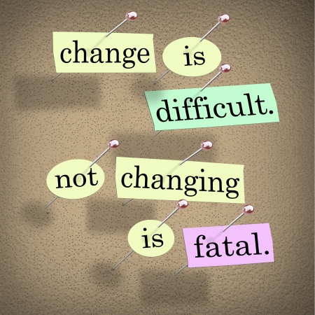 business change: The saying or motto Change is Difficult, Not Changing is Fatal with words stuck onto a bulletin board