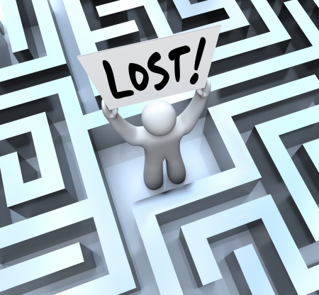 be lost: The word Lost on a sign held by a man or person stuck in a maze or labyrinth looking for a way out or to be rescued