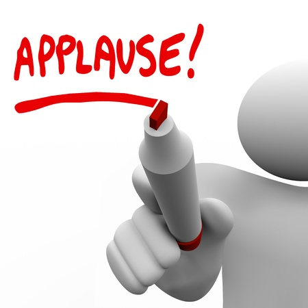 cheer: A man writing the word Applause with a red marker to ask an audience to give a big hand and show appreciation for a great job or to show approval for an idea
