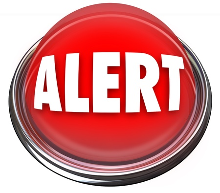 A round red button or light with the word Alert Stock Photo