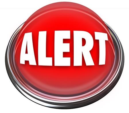 Een ronde rode knop of licht met het woord Alert Stockfoto