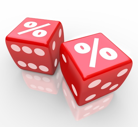 comparing: Percent signs on two red dice to symbolize taking a chance to win or find the best interest rates, inflation, savings, or other monetary concept Stock Photo
