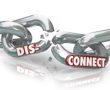 The word DIsconnect on metal chain links pulling apart to symbolize separation, dissolution, divorce,  or the end of a partnership photo