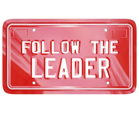 A red license plate with the words Follow the Leader to symbolize leadership, wisdom, mentoring and lessons learned to succeed in life, business or achieving a goal photo