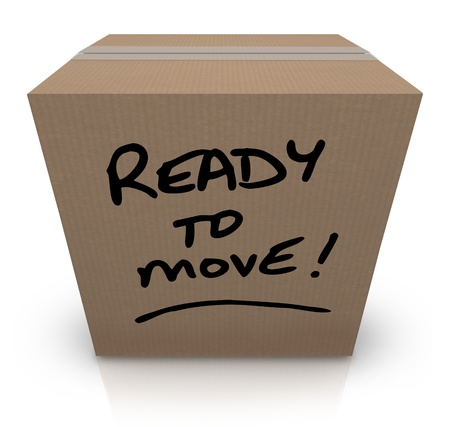 relocate: The words Ready to Move written on a cardboard box with black marker to indicate you are prepared to relocate or for moving to another location