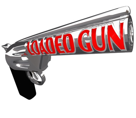 A pistol firearm with the words Loaded Gun on the barrel to symbolize being ready to shoot or commit a crime, the danger of criminal action Stock Photo - 15967189
