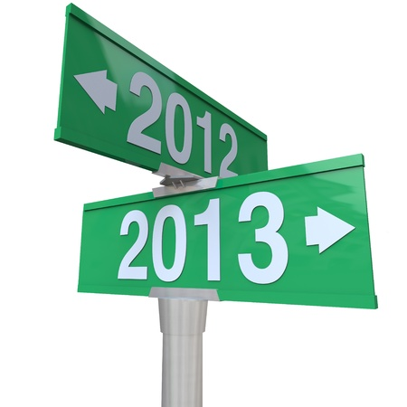 Green two-way road signs pointing from 2012 to 2013 to symbolize change to new year photo