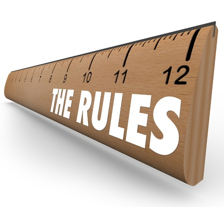 criterion: A wooden ruler with the words The Rules to represent laws, regulations, limits or guidelines meant to tell you what is allowable or forbidden behavior or activity