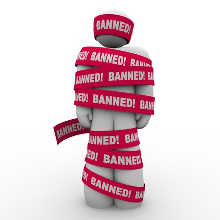 unauthorized: The word Banned in red tape wrapped around a man symbolizing speech or action that is illegal, forbidden, sanctioned, or not permitted Stock Photo