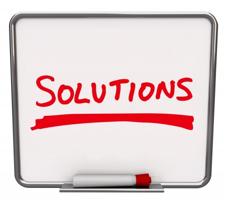 dry erase board: The word Solutions written on a white dry erase board with red marker to encourage you to look for answers and innovative ideas to solve a problem or dilemma Stock Photo