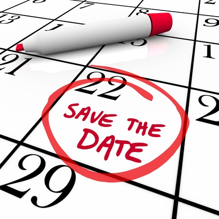 event planner: The words Save the Date written on a big white calendar to remind you to make and keep an important appointment or attend a major event or function