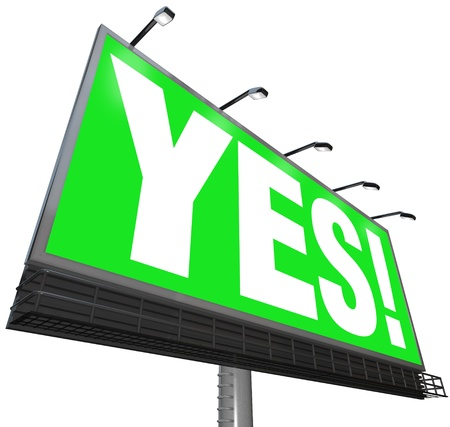 replying: The word Yes on a green outdoor advertising billboard sign Stock Photo