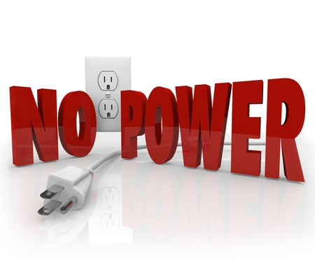 power failure: The words No Power in red letters in front of an electrical outlet and an unplugged cord to symbolize an electricity outage or energy failure