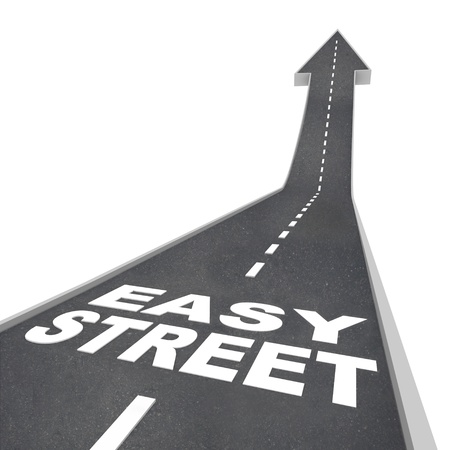 easy way: Easy Street words on a black paved road with arrow leading upward symbolizing luxurious living, a carefree lifestyle and comfortable living due to being wealthy or rich Stock Photo