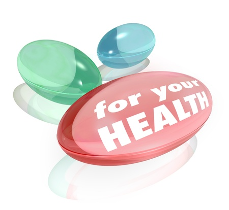 complementary: Three colorful vitamins or dietary supplements with the words For Your Health Stock Photo