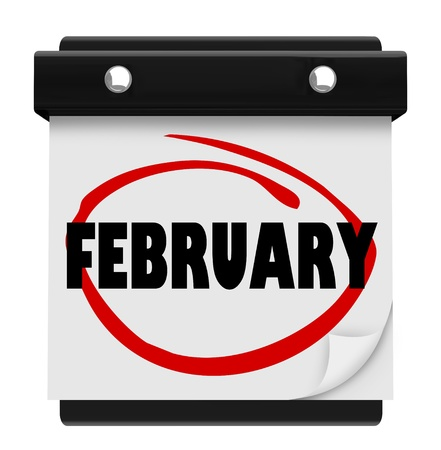 The word February on a wall calendar to remind you of important events during the winter month photo