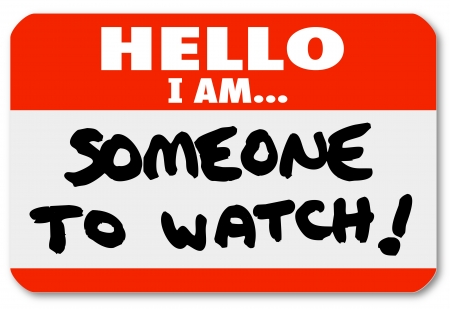 am: A namtag sticker with the words Hello I Am Someone to Watch to single out a special person or job candidate