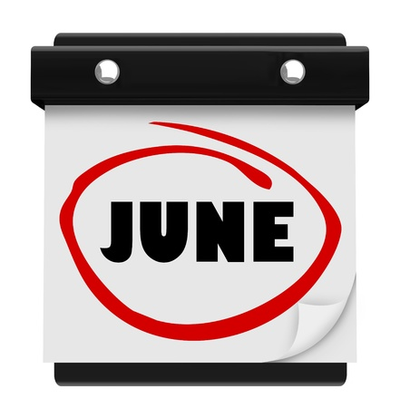 warmer: A wall calendar with the word June circled in red marker, reminding you of the change in months and switch from colder spring months to warmer summer monthly weather Stock Photo