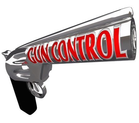 A pistol firearm with the words Gun Control as a plea to stop violence from shooting guns and hurting or killing innocent people photo
