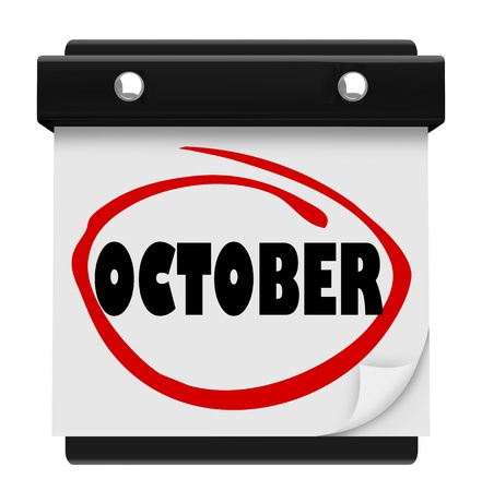 A wall calendar with the word October circled in red marker, reminding you of the change in months and time of autumn and Halloween Stock Photo - 17011680