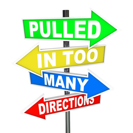 directional: The words Pulled in Too Many Directions on signs symbolizing feelings of stress, anxiety, pressure, confusion and feeling overworked
