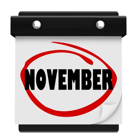 reminding: A wall calendar with the word November circled in red marker, reminding you of the change in months and time of autumn and Thanksgiving Stock Photo