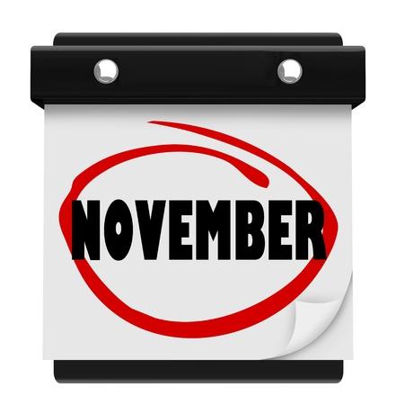 calendario noviembre: Un calendario de pared con la palabra círculo en noviembre marcador rojo, que le recuerda el cambio de mes y la hora de otoño y de Acción de Gracias