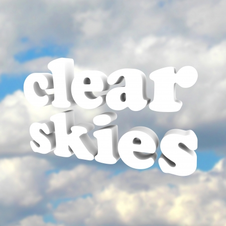 The words Clear Skies on a background of blue sky and fluffy white clouds to symbolize freedom of obstructions and complications