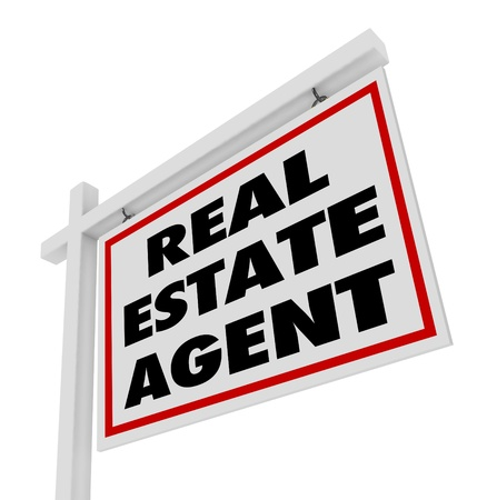 The words Real Estate Agent on a home or house for sale sign advertising an agency and its professional services aimed at selling or buying property photo