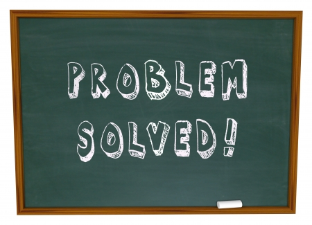 The words Problem Solved written on a school chalkboard or blackboard to symbolize successful resolution to an issue or trouble using creativity and innovation Stock Photo - 17288258