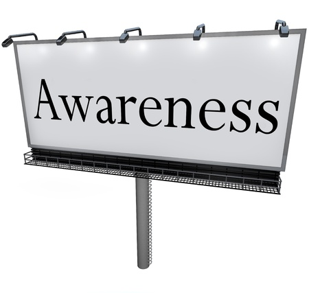 conscious: The word Awareness on a large outdoor billboard advertising sign to represent marketing, communication, and raising consciousness of important information