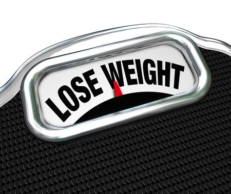 Las palabras bajar de peso en la pantalla de una escala para decirte que tienes que ir en una dieta para bajar de peso y retire la grasa para mejorar su salud Foto de archivo - 17674090
