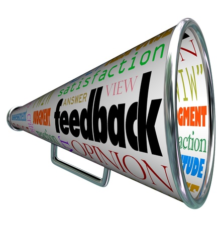 A megaphone or bullhorn with the word feedback and many related terms such as judgment, opinion, reaction, attitude, view, viewpoint, answer, satisfaction, and more Banque d'images