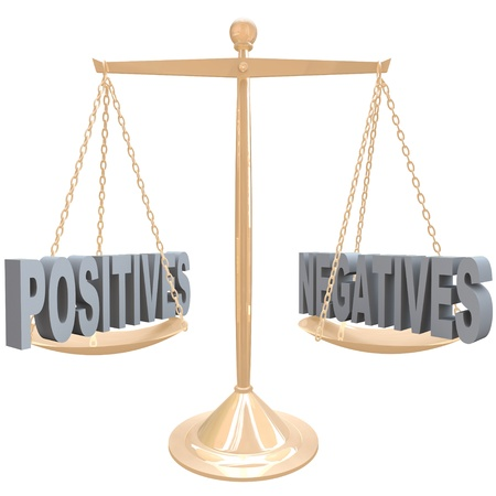 comparing: The words Positives and Negatives on opposite sides on a gold metal scale, symbolizing the comparision of differences between two choices or options