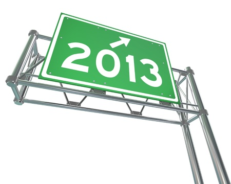 A green freeway sign with the new year 2013 on it photo