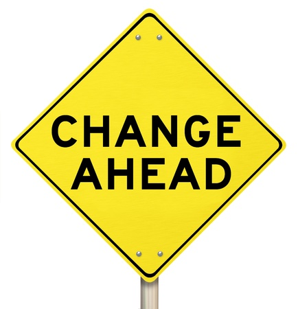 A yellow diamond-shaped road sign cautions people that change is ahead photo