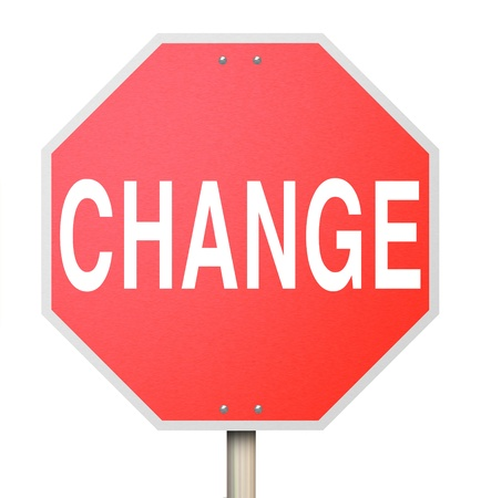 The word Change on a red octogon shapped sign isolated on white background Stock Photo - 17674300