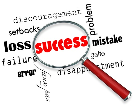 motivating: A magnifying glass hovering over several negative words but finding the word Success Stock Photo