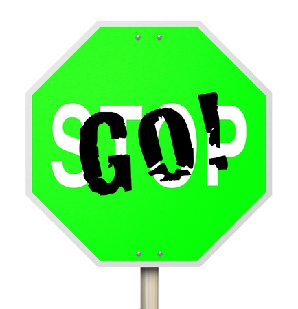 proceed: A stop sign that has been transformed with graffiti to read Go