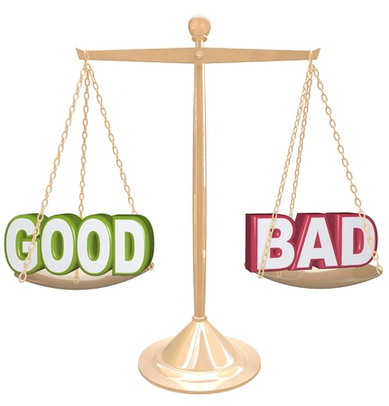 Weighing the good and bad of a situation or issue on a gold metal scale, one word on each side, measuring the positives and negatives Stock Photo - 17674140