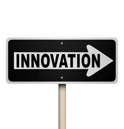 originality: A road sign with the word Innovation pointing the way to innovative ideas, imagination and originality to solve your problem or challenge