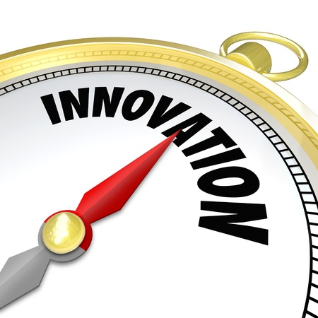 diverging: The word Innovation on a gold compass symbolizing new changes, progress, future advancement and advanced technology Stock Photo