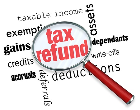 tax return: A magnifying glass hovering over several words, at the center of which is Tax Refund