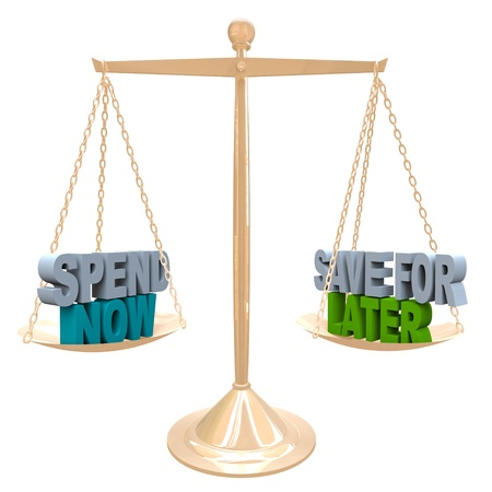 weighing: Weighing the benefits of saving your money for future needs vs spending it now for immediate gratification, words on a balance representing a balanced budget Stock Photo