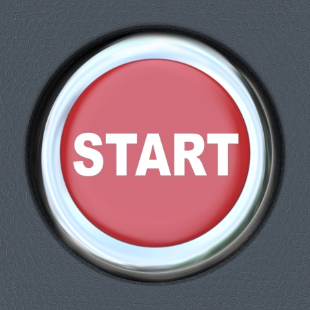 A red push button with the word Start on it photo