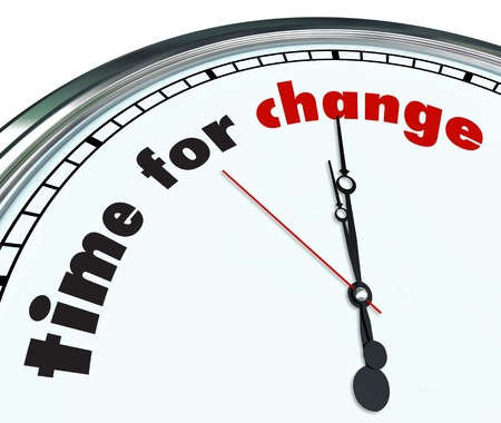 evolve: An ornate clock with the words Time for Change on its face Stock Photo
