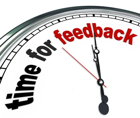 feedback: The words Time for Feedback on an ornate white clock, showing that it is time to collect input and responses in a question and answer session during a meeting or other group event Stock Photo