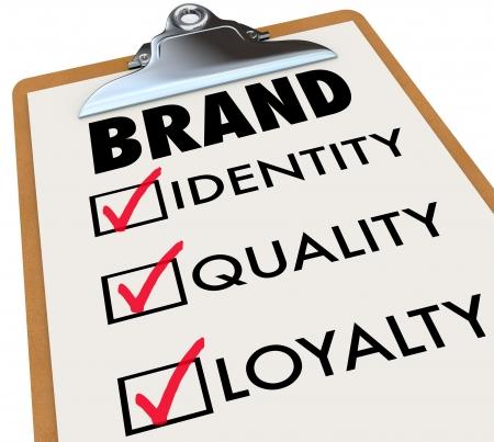 brand: The word brand and its core characteristics such as Identity, Quality and Loyalty written on a checklist on a clipboard to illustrate what you need to do to build your reputation among customers