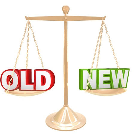 outweighing: Weigh the pros and cons of something old vs a new choice with words on a gold balance or scale comparing a newer or older product or object Stock Photo